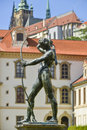 Statue city center of prague with bow and arrow on the background the historic builidings Stock Photography