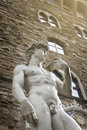 The statue of david from florence italy by michelangelo on piazza della signoria in Royalty Free Stock Photo