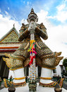 Statue of demon giant titan at wat arun landmark and no tourist attractions in thailand or temple the dawn is a buddhist temple Stock Photos
