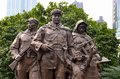 Statue depicting glory of chinese communist party shanghai china february a stature people s liberation army soldiers and two Royalty Free Stock Photos