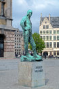 Statue of dock labourer near the antwerp city hall belgium with inscription labour freedom a memorial to resistance labourers in Stock Image