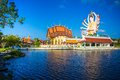 Statue of eighteen arms buddha part of temple complex wat plai laem in samui Stock Image
