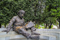 Statue of Einstein reading a book Royalty Free Stock Photo