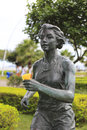 Statue of a female marathon runner there are many bronze statues commom athletes in amoy city Royalty Free Stock Photo