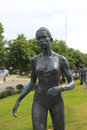 Statue of a female marathon runner there are many bronze statues commom athletes in amoy city Royalty Free Stock Image