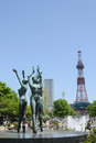 Statue of a fountain and sapporo tv tower at sapporo odori park in hokkaido japan Stock Photography