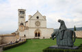Statue of francesco and basilica superiore assisi the papal st francis is the mother church the roman catholic order friars Stock Photography