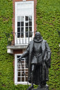 Statue of francis bacon in london with ivy background Royalty Free Stock Photos