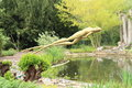 Statue of frog big jumping into pond in botanic garden in prague czech republic Stock Image