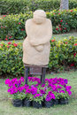 Statue in garden flower at khonkaen thailand Royalty Free Stock Photo
