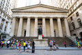 Statue of george washington outside federal hall in new york city usa august people take pictures on wall street city Royalty Free Stock Photo