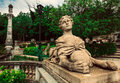 Statue of girl lioness with face and body a with ball in hands the garden with a a Royalty Free Stock Images