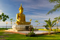 Statue of golden Buddha at the sea in Thailand Stock Photo