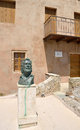 Statue of greek poet yiannis ritsos in monemvasia stands outside the house he lived Stock Photography