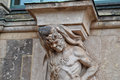 A statue with a heavy burden his tongue sticking out holding up pillar at the zwinger palace in dresden germany Stock Photography
