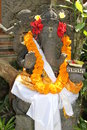 Statue of hindu god ganesha with red and orange flowers bali indonesia Royalty Free Stock Images
