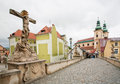 Statue with jesus on the cross past old church and bridge with cobbled stones klodzko poland of town klodzko city inhabitants Royalty Free Stock Photos