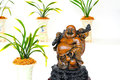 Statue laughing buddha arranged green plants vintage flower pots Royalty Free Stock Photos