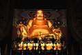 Statue of laughing buddha golden in chinese temple Royalty Free Stock Photography