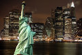 Statue of Liberty against night New York city, USA Royalty Free Stock Photo