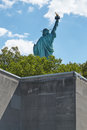 Statue of Liberty back seen behind a wall, sunny day Royalty Free Stock Photo