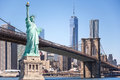 The statue of Liberty and Brooklyn Bridge with World Trade Center background, Landmarks of New York City Royalty Free Stock Photo