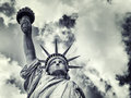 The Statue of Liberty with a dramatic sky Royalty Free Stock Photo