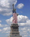 Statue of liberty draped in american flag Royalty Free Stock Photos