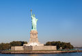 Statue liberty free tourists new york city downtown sunny early morning Royalty Free Stock Photography