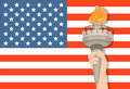 Statue of Liberty hand with torch and USA flag on background. July 4th. Independence Day