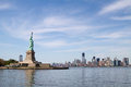 Statue of Liberty, and Manhattan Skyline behind it Royalty Free Stock Photo