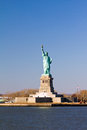 Statue of liberty in new york city tourist site on a clear sunny day Stock Images