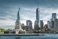 The Statue of Liberty with One World Trade Center background, Landmarks of New York City Royalty Free Stock Photo