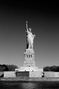 Statue of Liberty with pedestal and Liberty Island in black and white Royalty Free Stock Photo