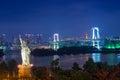 Statue of Liberty and Rainbow bridge in twilight at Odaiba Tokyo Royalty Free Stock Photo