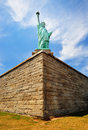 The statue of liberty a wide angle perspective symbolizing peace freedom and independence is one landmarks in manhattan new york Stock Photo