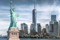 Image : The statue of Liberty with World Trade Center background, Landmarks of New York City  the holding