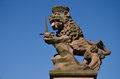 A statue of a lion at the loewenbrunnen lion s fountain at the university square in heidelberg germany is town on Royalty Free Stock Images