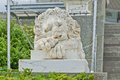 Statue of lion at the Vorontsov Palace facade in the resort town of Alupka. This palace is a tourist attraction of the Crimea.