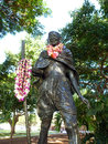 Statue of mahatma ghandi holding a walking stick and wearing rea real leis who lived october january located in kapiolani park in Royalty Free Stock Photography