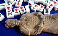 Statue and Mahjong tiles Stock Photo