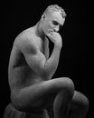Statue and makeup body topic inflated man with big muscles painted in white paint is cracked on a dark background studio Stock Photos