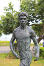 Statue of a male marathon runner there are many bronze statues commom athletes in amoy city Royalty Free Stock Image
