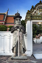 Statue of man doorman at wat pho temple in bangkok landmark and no tourist attractions in thailand or phra chettuphon wimon Royalty Free Stock Image