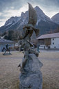Statue with man and eagle in alpine decor Royalty Free Stock Photo