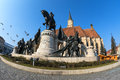 Statue of mathias rex in unirii square cluj napoca doves flying over the fisheye shot Royalty Free Stock Image