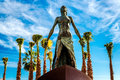 Statue of the mediterranea against blue sky and palm trees located in promenade fuengirola costa del sol malaga spain Stock Photography