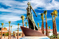 Statue of the mediterranea against blue sky and palm trees located in promenade fuengirola costa del sol malaga spain Royalty Free Stock Photo