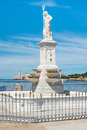 Statue of neptune and the castle of el morro in havana bay with background Royalty Free Stock Image