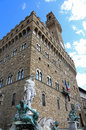 statue of Neptune in the fountain in Florence and Palazzo Vecchi Royalty Free Stock Photo
